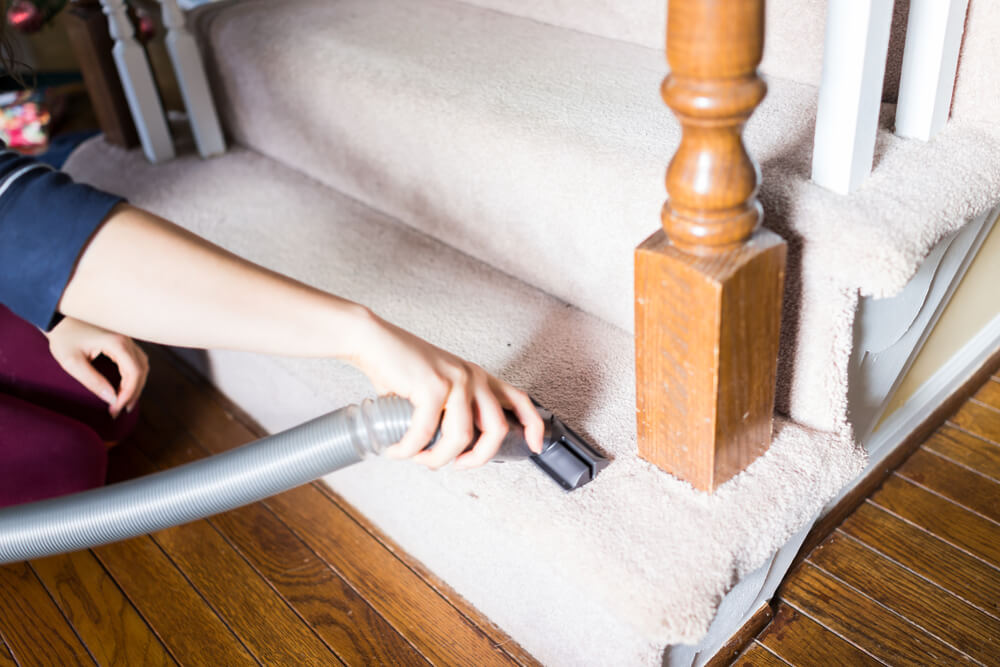 Why should I clean my carpeted stairs