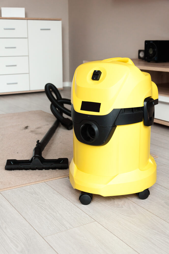 How do you use a shop vac to pick up water
