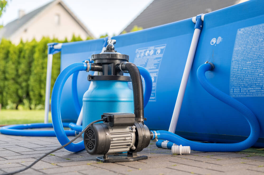 Sand filter system next to a pool in your own garden